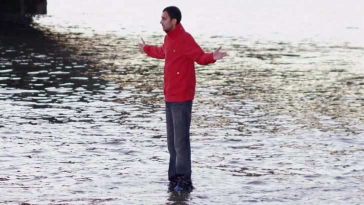 The magician Dynamo using his illusion of walking on the water.