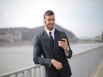 man-in-black-suit-jacket-holding-black-smartphone